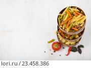 Купить «Raw pasta and spices in wooden bowls», фото № 23458386, снято 27 июня 2016 г. (c) Елена Блохина / Фотобанк Лори