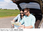 Купить «happy man and woman with road map at hatchback car», фото № 23460686, снято 12 июня 2016 г. (c) Syda Productions / Фотобанк Лори