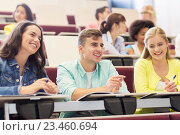 group of students with notebooks in lecture hall. Стоковое фото, фотограф Syda Productions / Фотобанк Лори