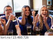 Купить «football fans or friends with beer at sport bar», фото № 23460726, снято 14 июля 2016 г. (c) Syda Productions / Фотобанк Лори