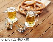Купить «close up of beer, pretzels and peanuts on table», фото № 23460730, снято 22 июля 2016 г. (c) Syda Productions / Фотобанк Лори