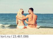 Купить «happy couple in swimwear sitting on summer beach», фото № 23461086, снято 11 августа 2015 г. (c) Syda Productions / Фотобанк Лори