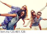 Купить «happy hippie friends having fun on cereal field», фото № 23461126, снято 27 августа 2015 г. (c) Syda Productions / Фотобанк Лори