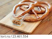 Купить «close up of peanuts and pretzels on wooden table», фото № 23461554, снято 22 июля 2016 г. (c) Syda Productions / Фотобанк Лори