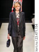 Купить «MILAN, ITALY - SEPTEMBER 28: A model walks the runway during the Giorgio Armani fashion show as part of Milan Fashion Week Spring/Summer 2016 on September 28, 2015 in Milan, Italy.», фото № 23471154, снято 28 сентября 2015 г. (c) Anton Oparin / Фотобанк Лори