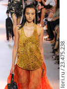 Купить «MILAN, ITALY - SEPTEMBER 26: A model walks the runway during the Roberto Cavalli fashion show as part of Milan Fashion Week Spring/Summer 2016 on September 26, 2015 in Milan, Italy.», фото № 23475238, снято 26 сентября 2015 г. (c) Anton Oparin / Фотобанк Лори