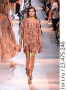 Купить «MILAN, ITALY - SEPTEMBER 26: A model walks the runway during the Roberto Cavalli fashion show as part of Milan Fashion Week Spring/Summer 2016 on September 26, 2015 in Milan, Italy.», фото № 23475246, снято 26 сентября 2015 г. (c) Anton Oparin / Фотобанк Лори