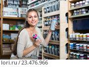 Купить «woman choosing paint in aerosol can in shop», фото № 23476966, снято 21 октября 2018 г. (c) Яков Филимонов / Фотобанк Лори