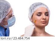 Купить «Young woman preparing for injection of botox isolated on white», фото № 23484754, снято 30 мая 2016 г. (c) Elnur / Фотобанк Лори