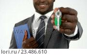 Купить «Portrait of businessman with documents holding up keys », видеоролик № 23486610, снято 23 ноября 2019 г. (c) Wavebreak Media / Фотобанк Лори