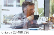 Купить «Businessman discussing with colleague in office cafeteria», видеоролик № 23488726, снято 14 декабря 2019 г. (c) Wavebreak Media / Фотобанк Лори