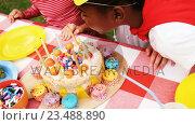 Купить «Kids in various costumes celebrating birthday», видеоролик № 23488890, снято 16 июля 2019 г. (c) Wavebreak Media / Фотобанк Лори