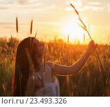 Купить «Beautiful brunette women in wheat field at sunset», фото № 23493326, снято 13 июня 2016 г. (c) Майя Крученкова / Фотобанк Лори