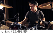 Купить «male musician playing drums and cymbals at concert», видеоролик № 23498894, снято 25 августа 2016 г. (c) Syda Productions / Фотобанк Лори