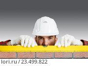 Купить «Builder man with level . Mixed media», фото № 23499822, снято 8 сентября 2015 г. (c) Sergey Nivens / Фотобанк Лори