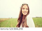 Купить «smiling young hippie woman on cereal field», фото № 23504218, снято 27 августа 2015 г. (c) Syda Productions / Фотобанк Лори