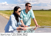 Купить «happy man and woman with road map on car hood», фото № 23504362, снято 12 июня 2016 г. (c) Syda Productions / Фотобанк Лори