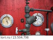 Купить «close up of vintage valve mechanism at factory», фото № 23504798, снято 27 июня 2016 г. (c) Syda Productions / Фотобанк Лори