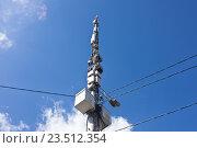 Купить «Вышка с антеннами и передатчиками на фоне синего неба», фото № 23512354, снято 3 сентября 2016 г. (c) Victoria Demidova / Фотобанк Лори