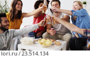 Купить «friends with drinks and snacks talking at home», видеоролик № 23514134, снято 18 августа 2016 г. (c) Syda Productions / Фотобанк Лори