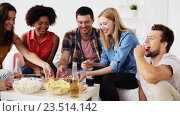 Купить «happy friends with drinks eating pizza at home», видеоролик № 23514142, снято 18 августа 2016 г. (c) Syda Productions / Фотобанк Лори