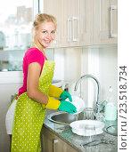 Купить «Adult cheerful girl wearing apron», фото № 23518734, снято 4 августа 2020 г. (c) Яков Филимонов / Фотобанк Лори