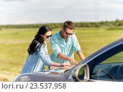 Купить «happy man and woman with road map on car hood», фото № 23537958, снято 12 июня 2016 г. (c) Syda Productions / Фотобанк Лори