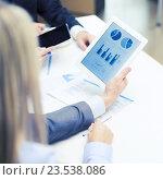 Купить «business team with graph on tablet pc screen», фото № 23538086, снято 9 ноября 2013 г. (c) Syda Productions / Фотобанк Лори