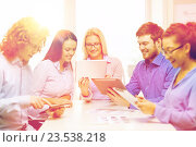 smiling team with table pc and papers working. Стоковое фото, фотограф Syda Productions / Фотобанк Лори