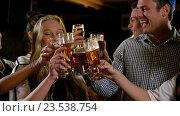Купить «Group of friends toasting glass of beers», видеоролик № 23538754, снято 11 июля 2020 г. (c) Wavebreak Media / Фотобанк Лори