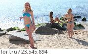 Купить «woman wearing swimwear standing on sandy beach», видеоролик № 23545894, снято 22 июня 2016 г. (c) Яков Филимонов / Фотобанк Лори
