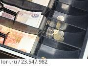 Купить «Деньги в кассовом аппарате», эксклюзивное фото № 23547982, снято 18 сентября 2016 г. (c) Яна Королёва / Фотобанк Лори