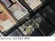 Купить «Деньги в кассовом аппарате», эксклюзивное фото № 23547994, снято 18 сентября 2016 г. (c) Яна Королёва / Фотобанк Лори
