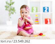 Купить «Child girl playing with toy at home», фото № 23549262, снято 26 мая 2015 г. (c) Оксана Кузьмина / Фотобанк Лори