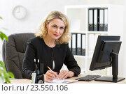 Купить «Middle-aged business woman working at pc in office», фото № 23550106, снято 19 декабря 2014 г. (c) Оксана Кузьмина / Фотобанк Лори