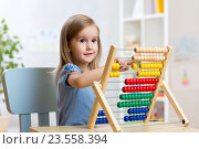 Купить «little girl playing with toys», фото № 23558394, снято 30 сентября 2015 г. (c) Оксана Кузьмина / Фотобанк Лори