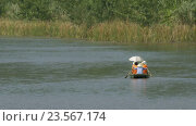 Купить «Trang an bai in Hanoi, Vietnam on a scenic river sailing boat», видеоролик № 23567174, снято 13 мая 2016 г. (c) Данил Руденко / Фотобанк Лори