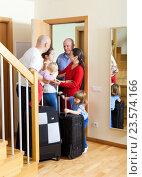 Купить «Family seeing off the relatives to vacations», фото № 23574166, снято 2 ноября 2013 г. (c) Яков Филимонов / Фотобанк Лори