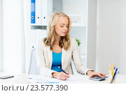 Купить «businesswoman with calculator counting at office», фото № 23577390, снято 31 июля 2016 г. (c) Syda Productions / Фотобанк Лори