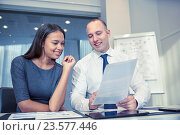 Купить «smiling businesspeople with papers in office», фото № 23577446, снято 25 октября 2014 г. (c) Syda Productions / Фотобанк Лори