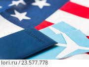 Купить «american flag, passport and air tickets», фото № 23577778, снято 30 июня 2016 г. (c) Syda Productions / Фотобанк Лори