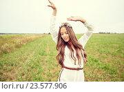 Купить «smiling young hippie woman on cereal field», фото № 23577906, снято 27 августа 2015 г. (c) Syda Productions / Фотобанк Лори