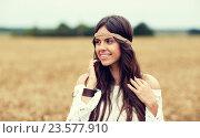 Купить «smiling young hippie woman on cereal field», фото № 23577910, снято 27 августа 2015 г. (c) Syda Productions / Фотобанк Лори