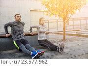 Купить «couple doing triceps dip on city street bench», фото № 23577962, снято 17 октября 2015 г. (c) Syda Productions / Фотобанк Лори