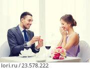 Купить «man proposing to his girlfriend at restaurant», фото № 23578222, снято 9 марта 2014 г. (c) Syda Productions / Фотобанк Лори