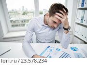 stressed businessman with papers in office, фото № 23578234, снято 18 июня 2015 г. (c) Syda Productions / Фотобанк Лори