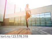 Купить «woman making step exercise on city street bench», фото № 23578318, снято 17 октября 2015 г. (c) Syda Productions / Фотобанк Лори