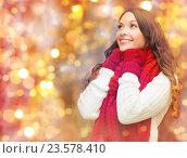 Купить «happy woman in scarf and mittens over lights», фото № 23578410, снято 22 сентября 2013 г. (c) Syda Productions / Фотобанк Лори