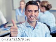 Купить «group of smiling businesspeople meeting in office», фото № 23579526, снято 25 октября 2014 г. (c) Syda Productions / Фотобанк Лори