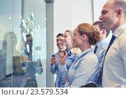 Купить «smiling business people with marker and stickers», фото № 23579534, снято 22 апреля 2019 г. (c) Syda Productions / Фотобанк Лори
